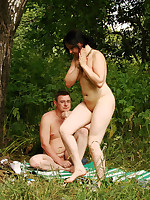 Couple relaxing at nude beach