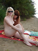 Pussy loving ladies get frisky at the nude beach